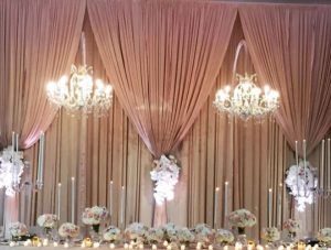 drapes and chandelier for wedding reception